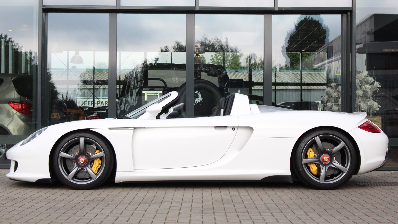 Porsche carrera gt liberty cars exclusive automotive for Motor car portfolio site inventory